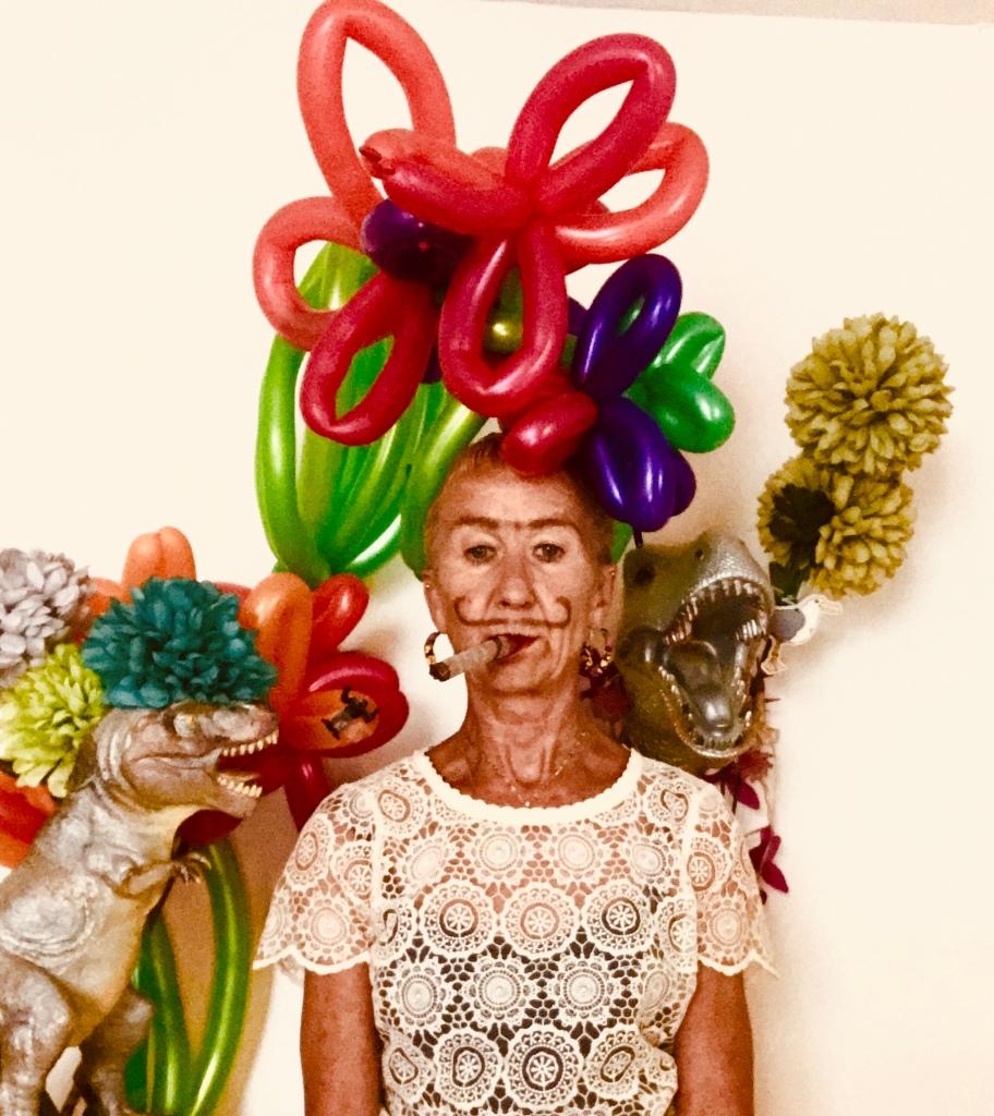 Katy headshot with balloons and dinosaurs